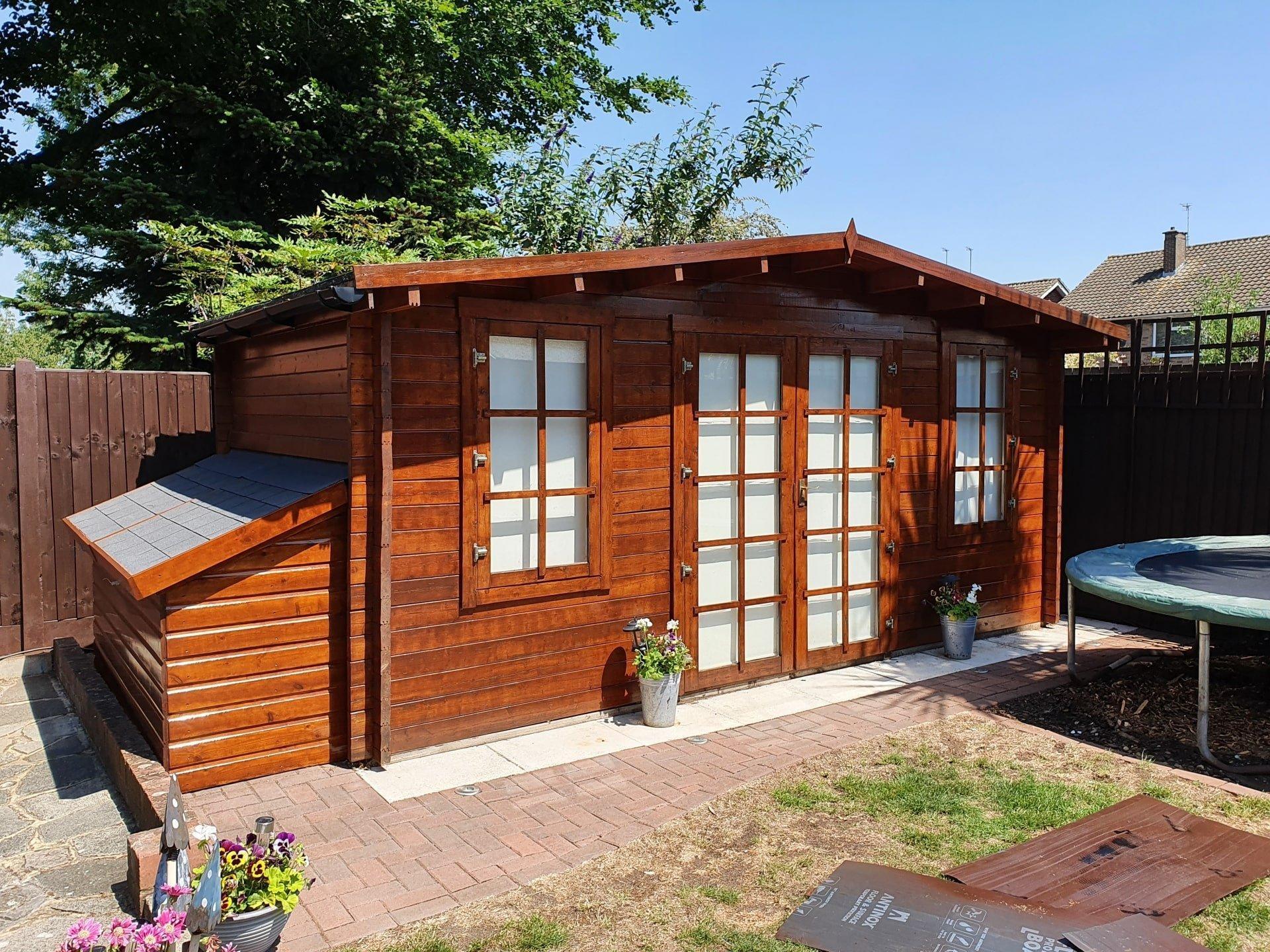 A freshly varnished summerhouse.