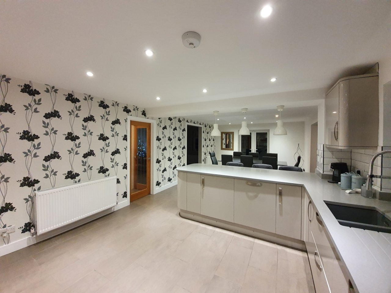 A contemporary bold black and white kitchen