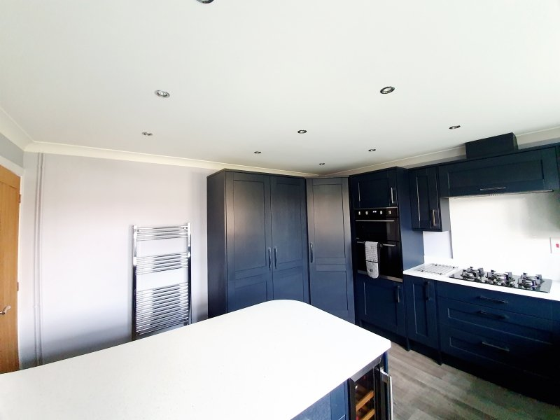 A navy and white kitchen
