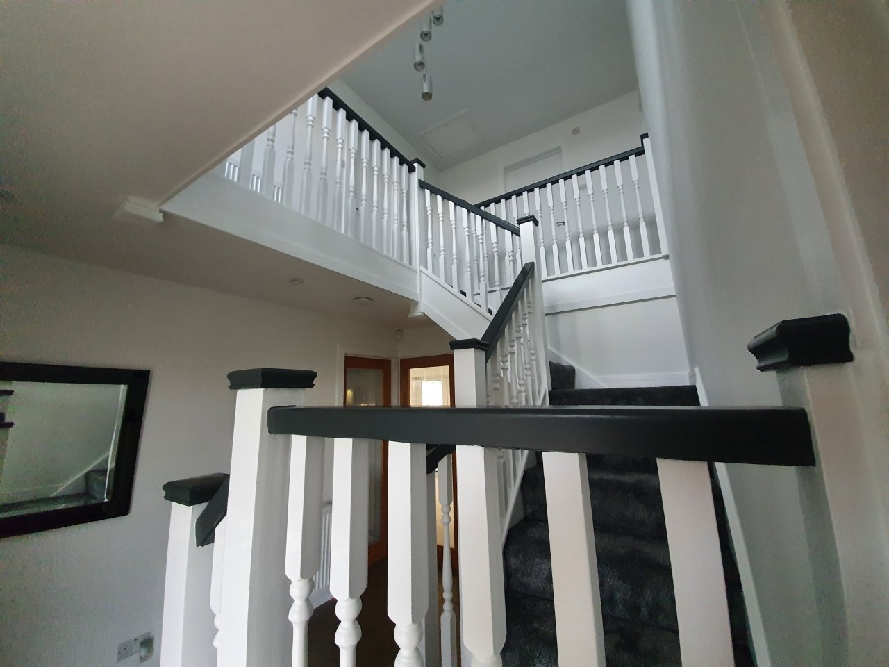 Contrasting grey and white hallway