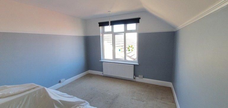 Calming grey bedroom after decorating